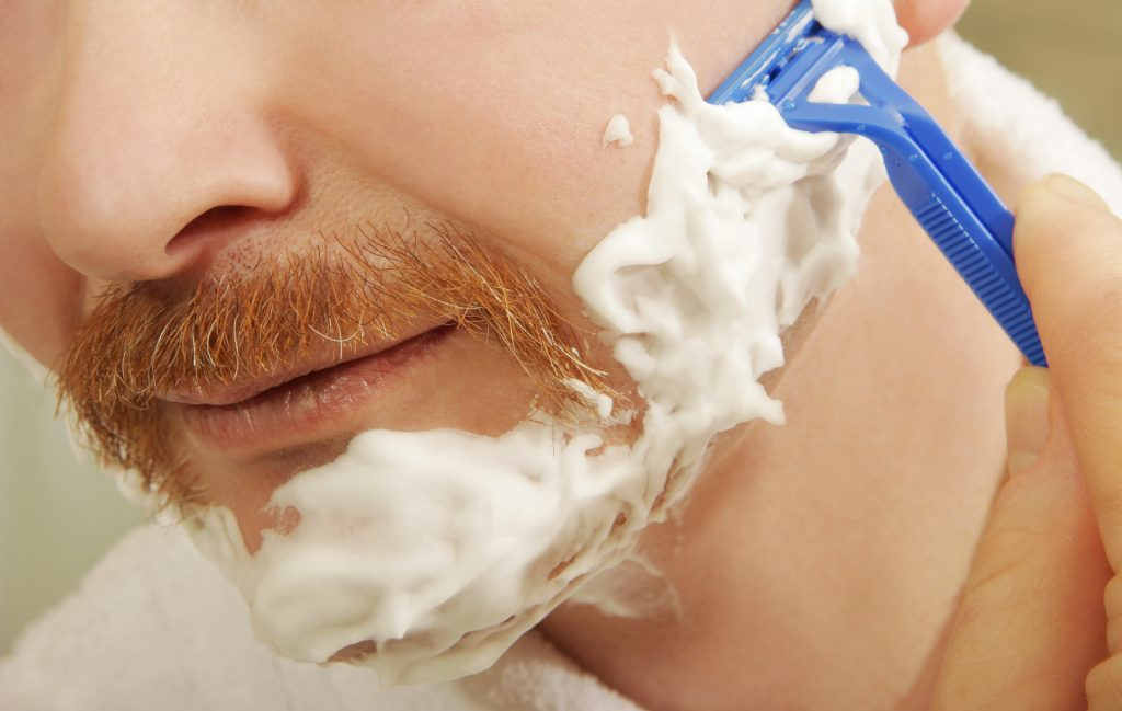 men with shaving soap