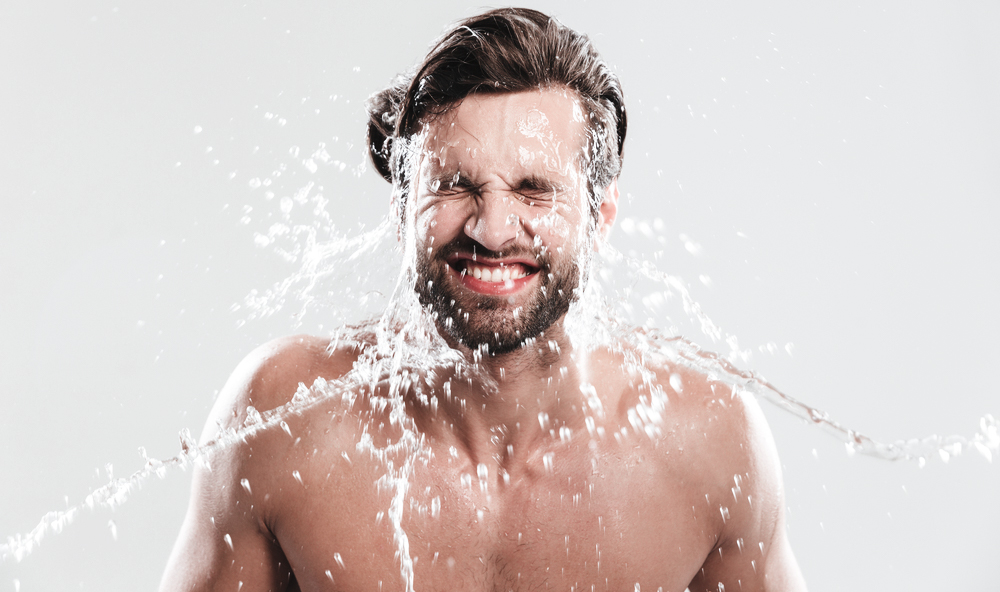 man washing his beard