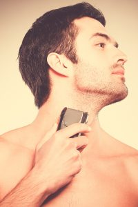 shaving with an electric razor