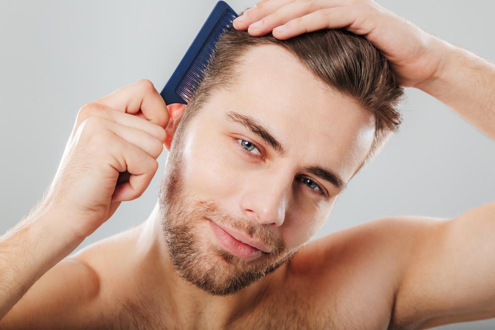 Eric White Combing Hair