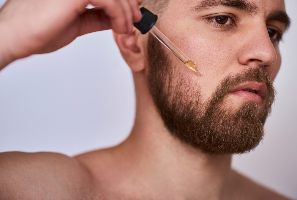 Man applying beard oil