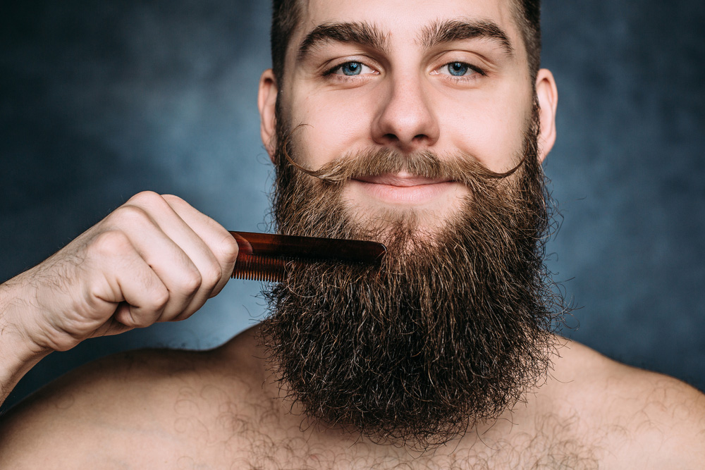 Man with beard comb