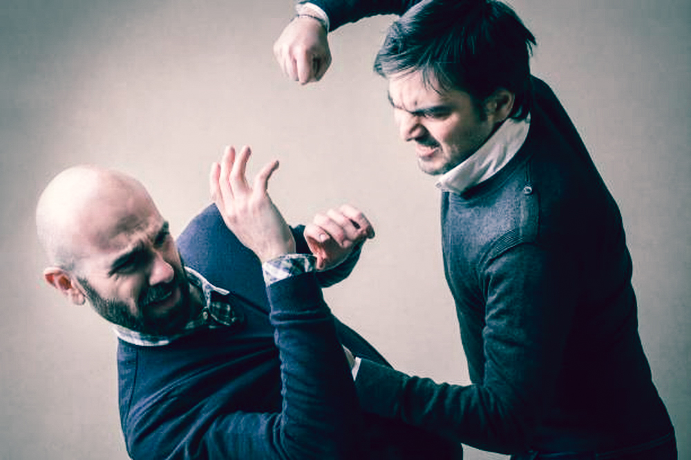 man without beard fighting with a beard man