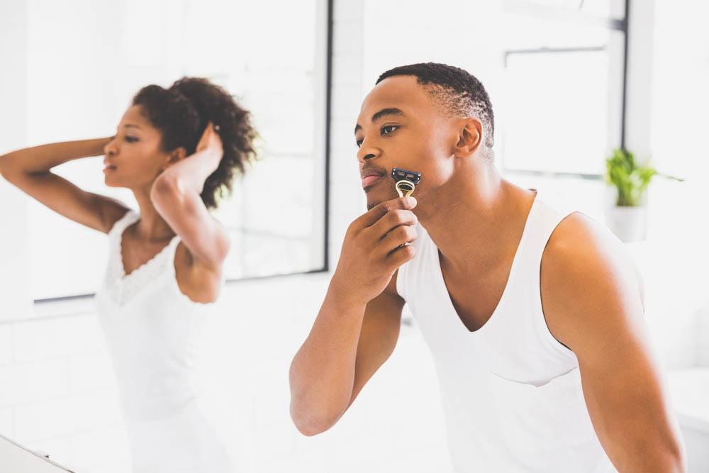 a black man using a flexible razor