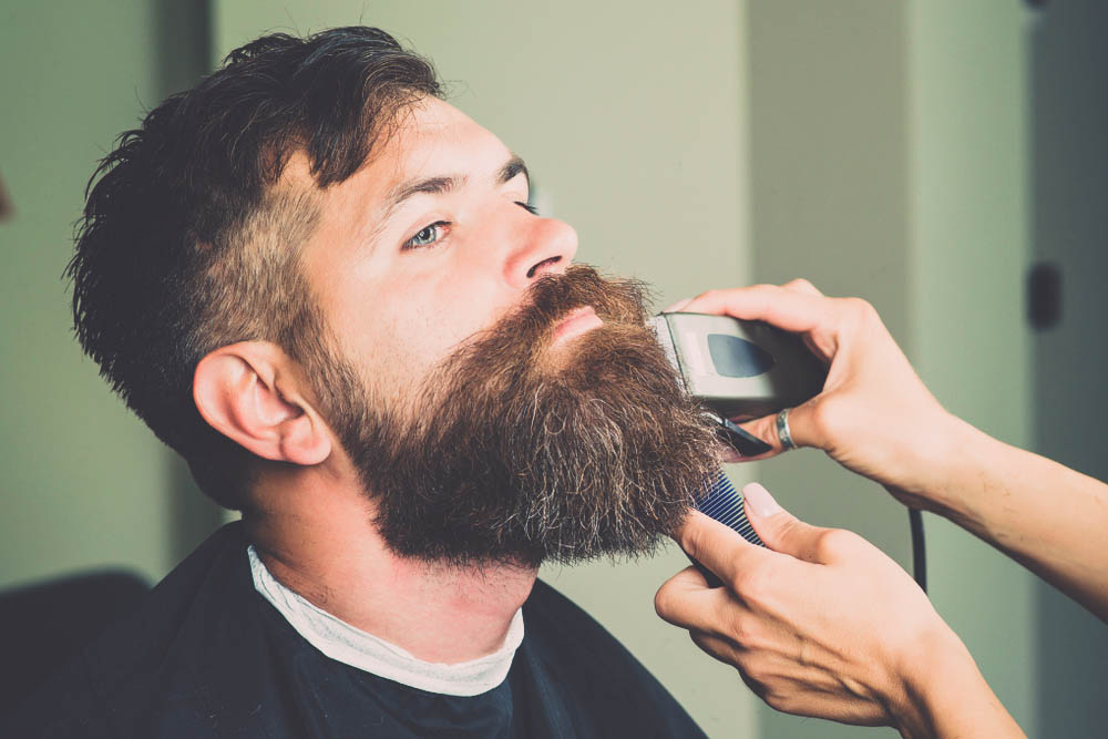 trimming long beard with clippers
