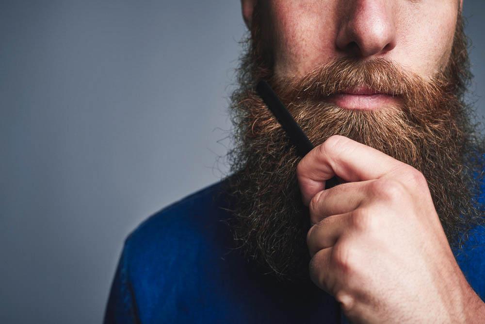 combing beard after applying wax