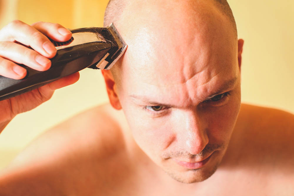 removing hair with clipper on bald head
