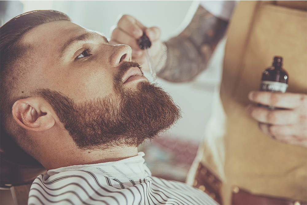 Barber Applying Beard Oil