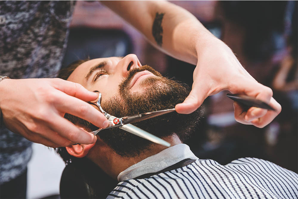 Hair Stylist Trimming Men's Beard