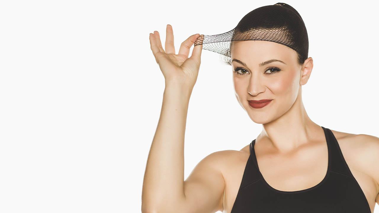 women stretching mesh wig cap