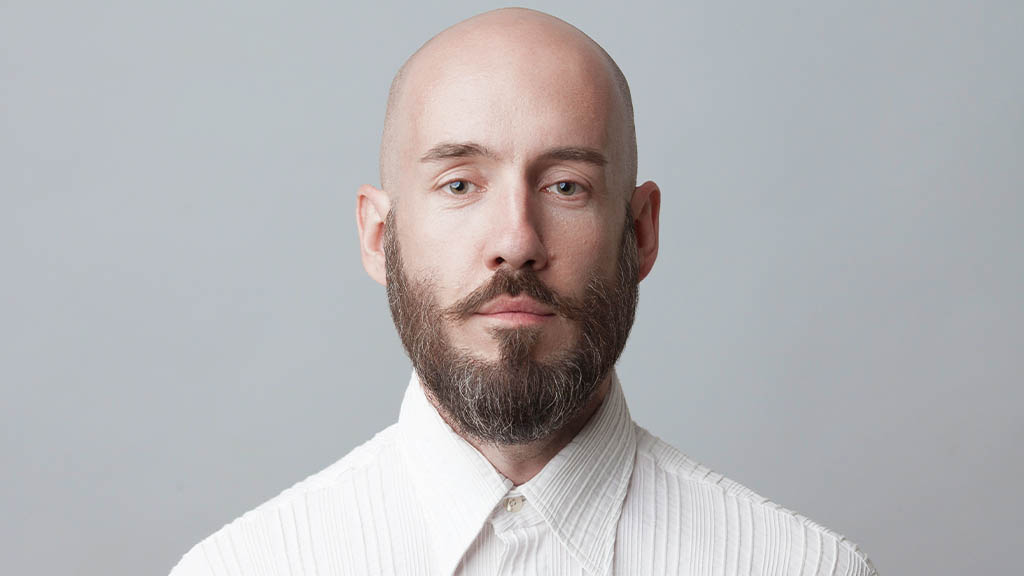 bearded man with shaved head