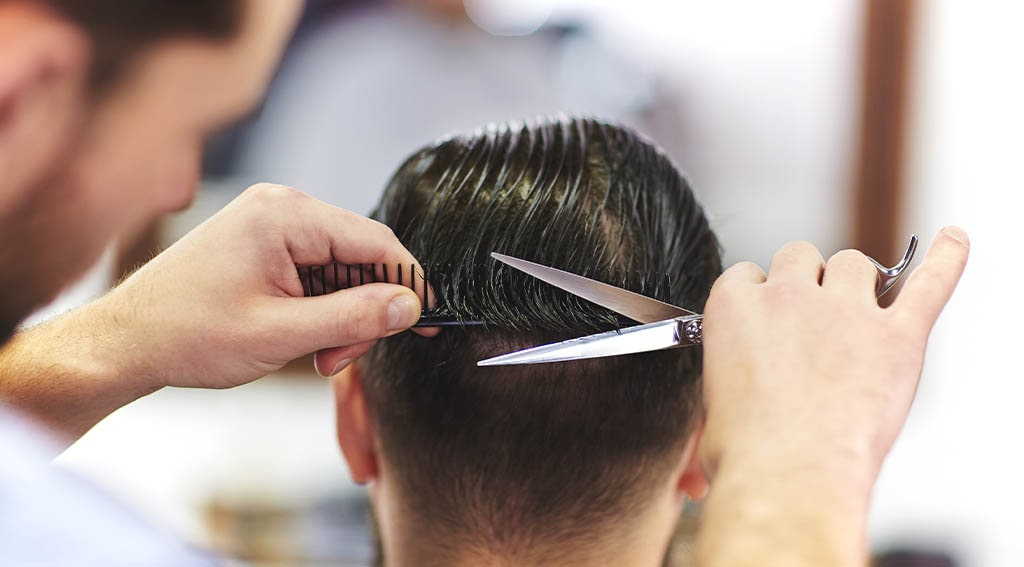 cutting long hair with scissors